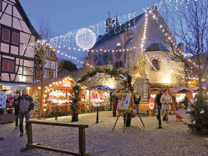 La Ronde du veilleur de nuit vous emmène à travers le marché de Noël d\'Eguisheim